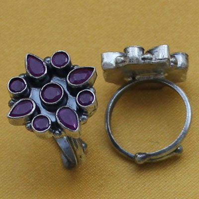 Flower design silver toe ring with red stone