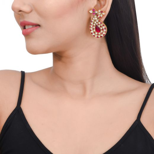Gold tone silver earrings in paisley design