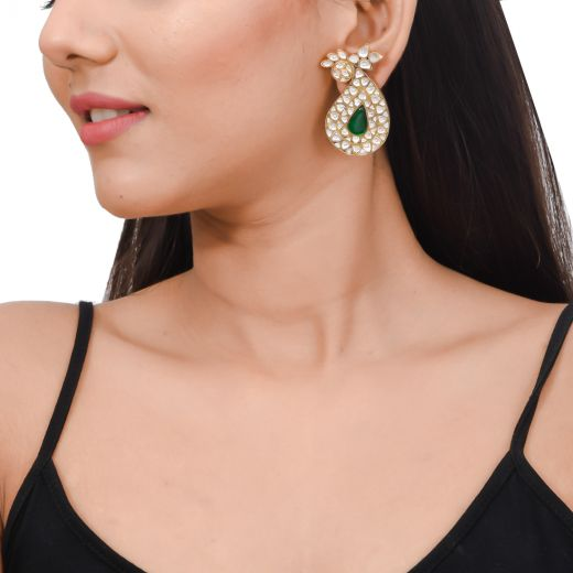 Gold polish paisley design silver earrings with white stone