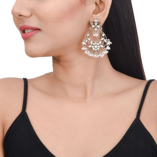 Floral Chandbali silver earrings with white stones