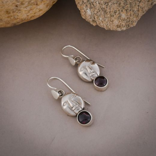 Hand Curved face silver earrings with pink stone
