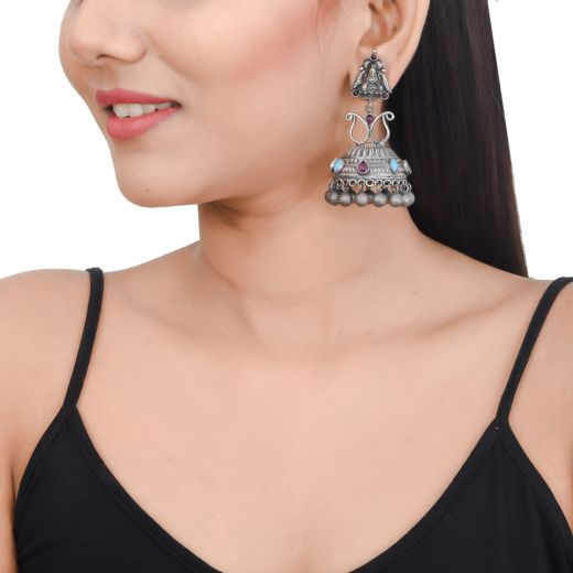 Antique silver jhumkas in temple work with pink and turquoise stone