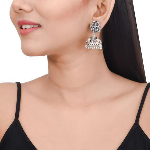 Temple work silver jhumkas with pink stones